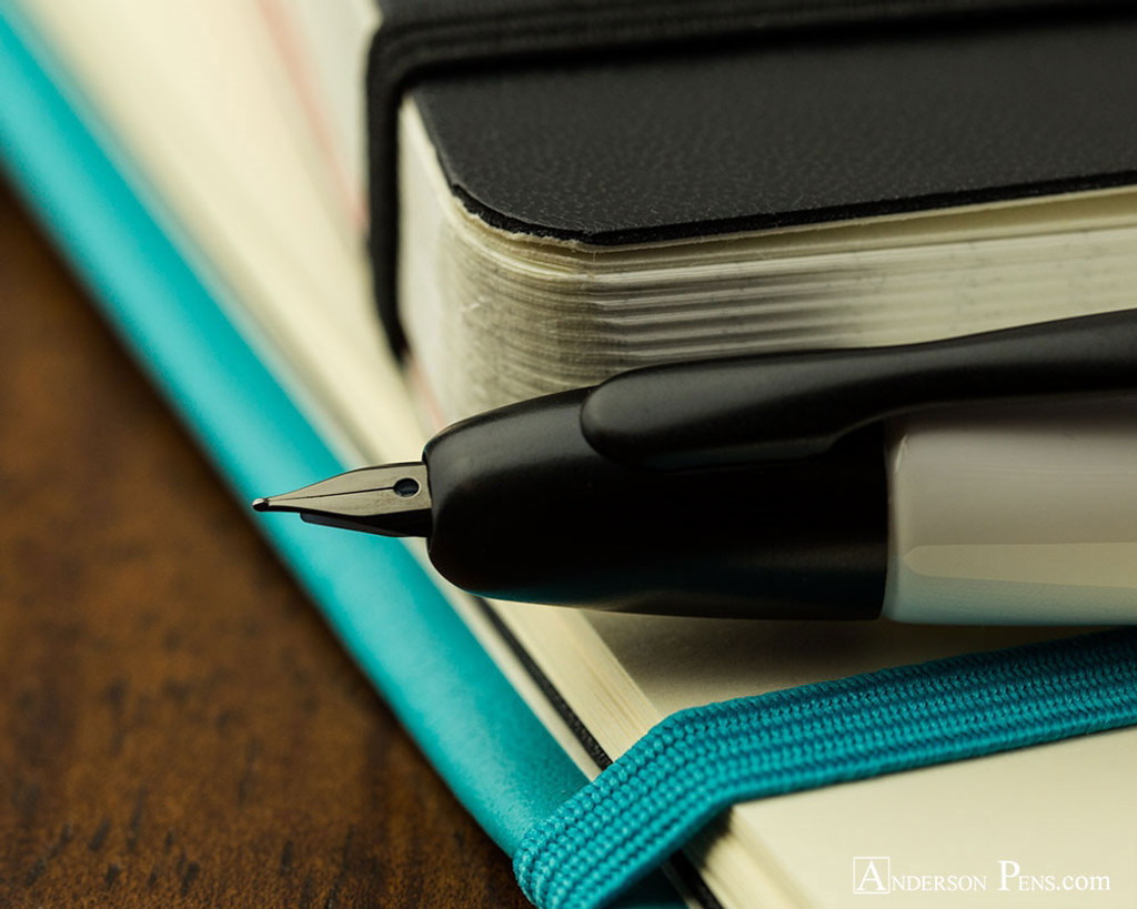 Pilot Vanishing Point Fountain Pen - White with Matte Black Trim - Nib on Notebook
