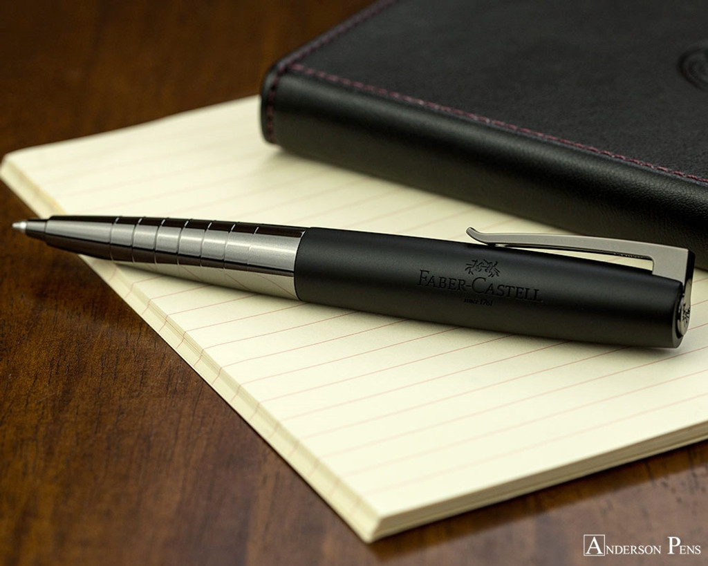 Faber-Castell Loom Ballpoint - Gunmetal Polished - Open on Notebook