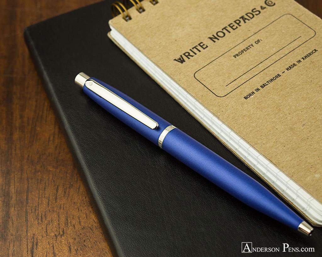 Sheaffer VFM Ballpoint - Neon Blue - On Notebook