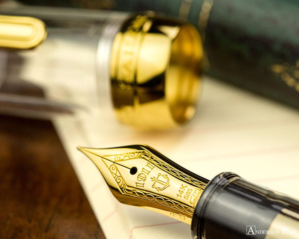 Sailor 1911 Standard Fountain Pen - Transparent with Gold Trim - Nib on Notebook