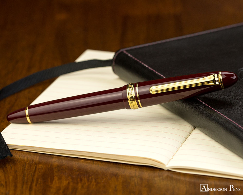 Sailor 1911 Standard Fountain Pen - Maroon with Gold Trim - Closed on Notebook