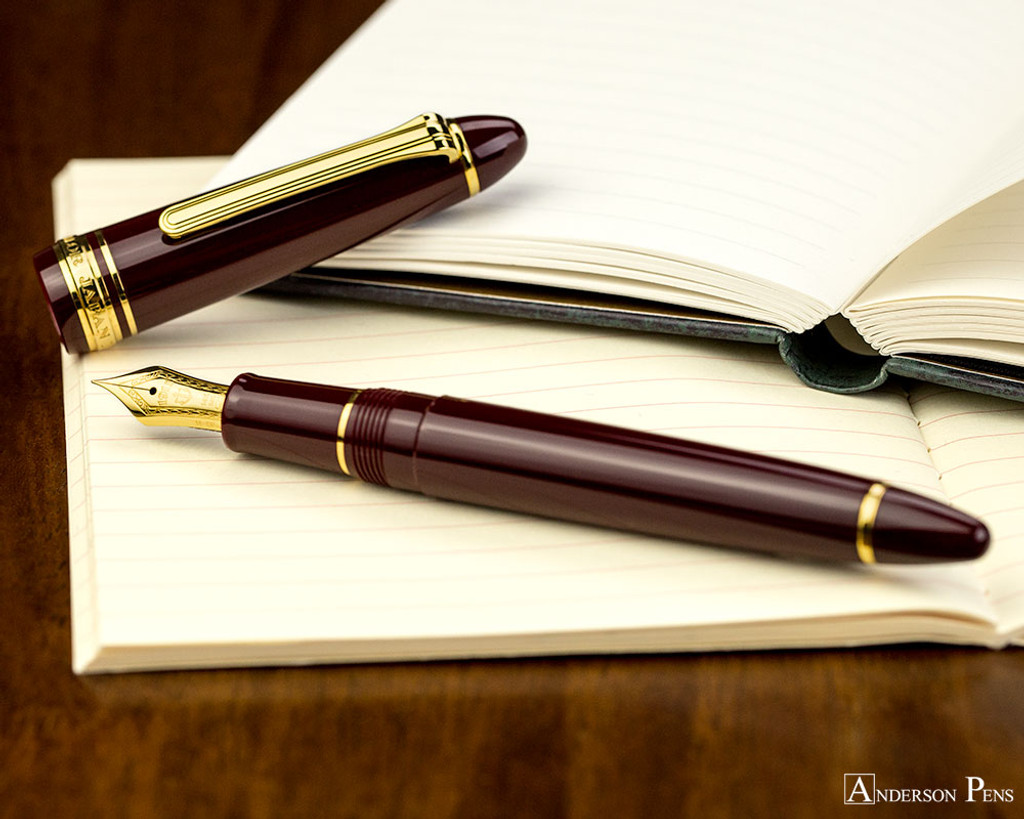 Sailor 1911 Standard Fountain Pen - Maroon with Gold Trim - Open on Notebook