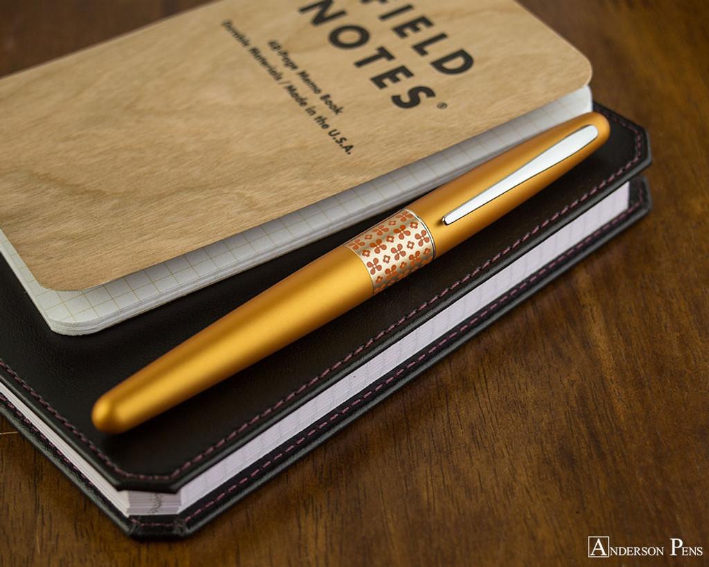 Pilot Metropolitan Fountain Pen - Retro Pop Orange - On Notebook