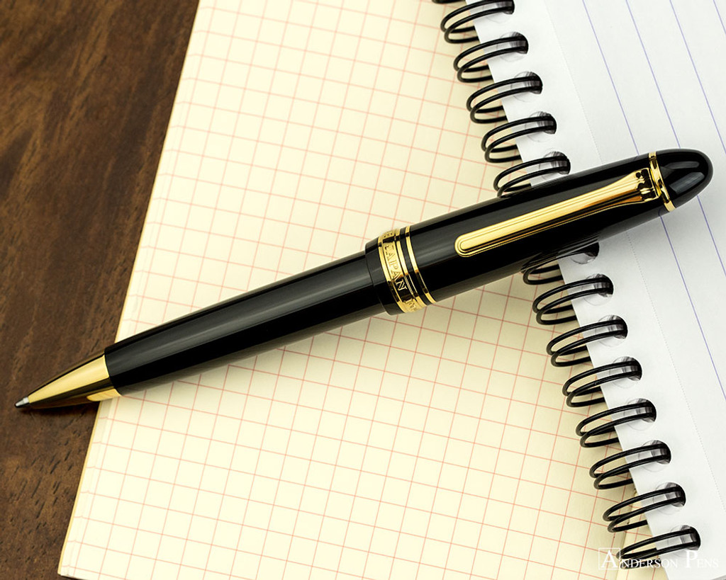 Sailor 1911 Large Ballpoint - Black with Gold Trim - Open on Notebook