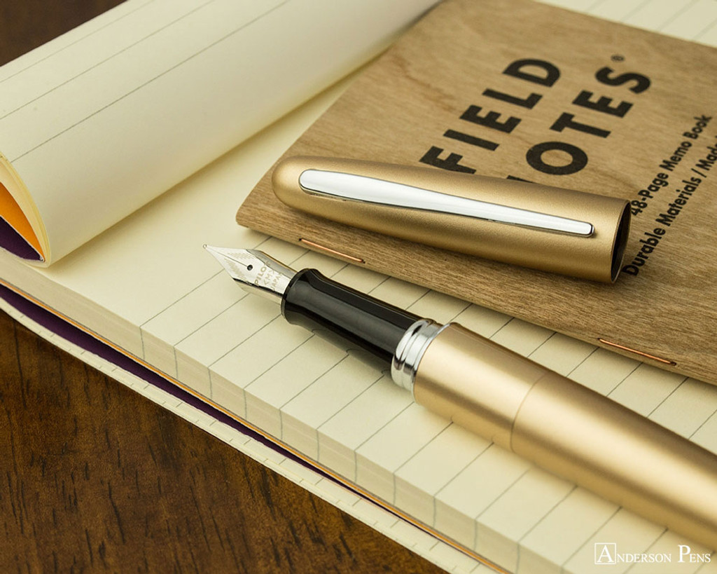 Pilot Metropolitan Fountain Pen - Gold Plain - Open on Notebook