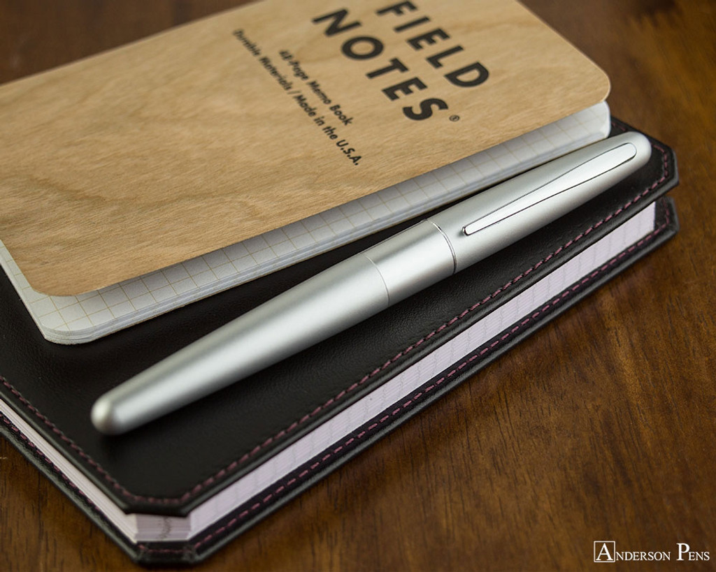 Pilot Metropolitan Fountain Pen - Silver Plain - Closed on Notebook