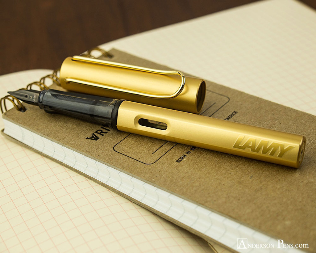 Lamy LX Fountain Pen - Gold - On Notebook Open
