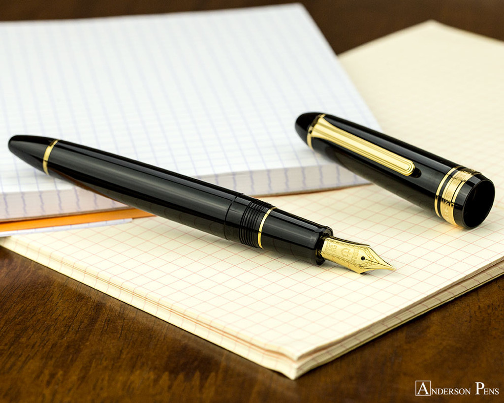 Sailor 1911 Large Fountain Pen - Black with Gold Trim - Open on Notebook