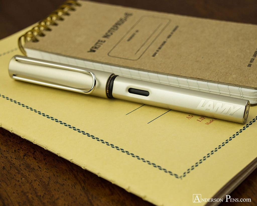 Lamy LX Fountain Pen - Palladium - On Notebook