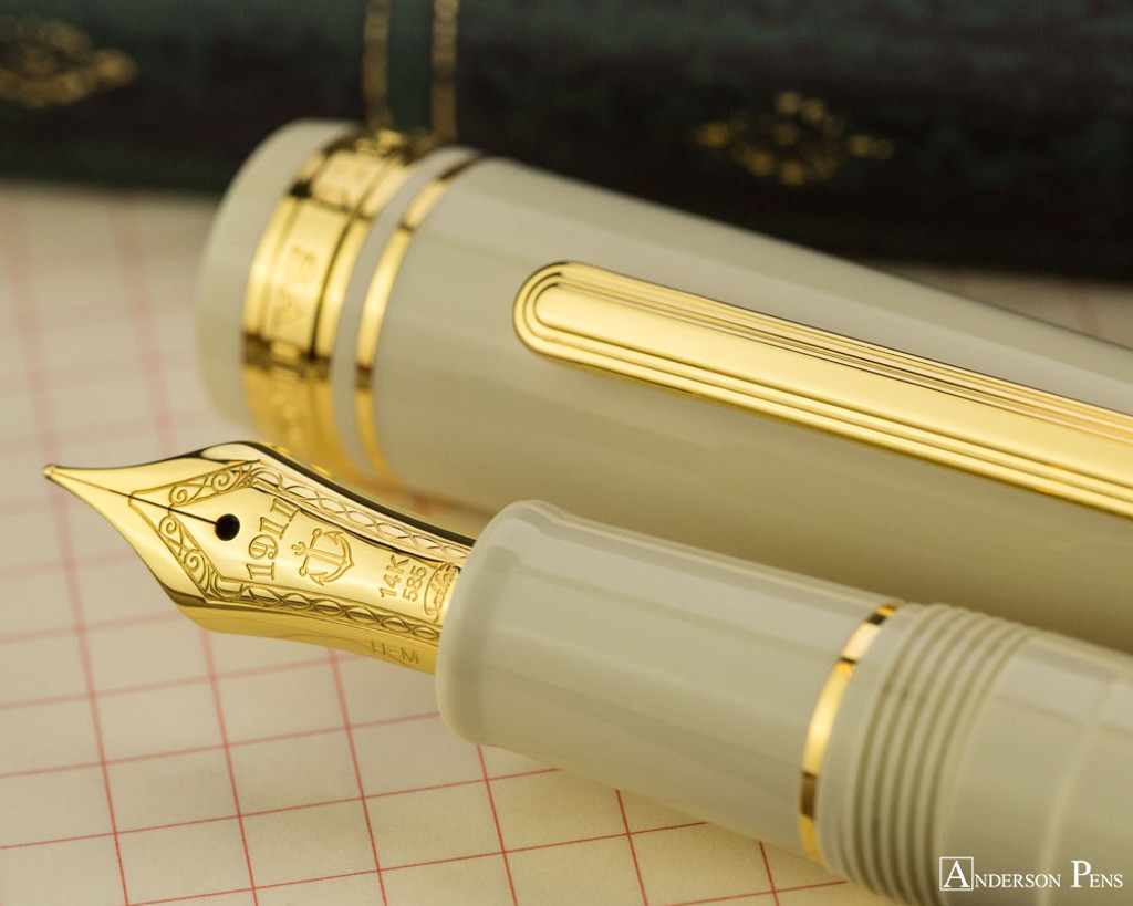 Sailor 1911 Standard Fountain Pen - Ivory with Gold Trim - Nib on Notebook