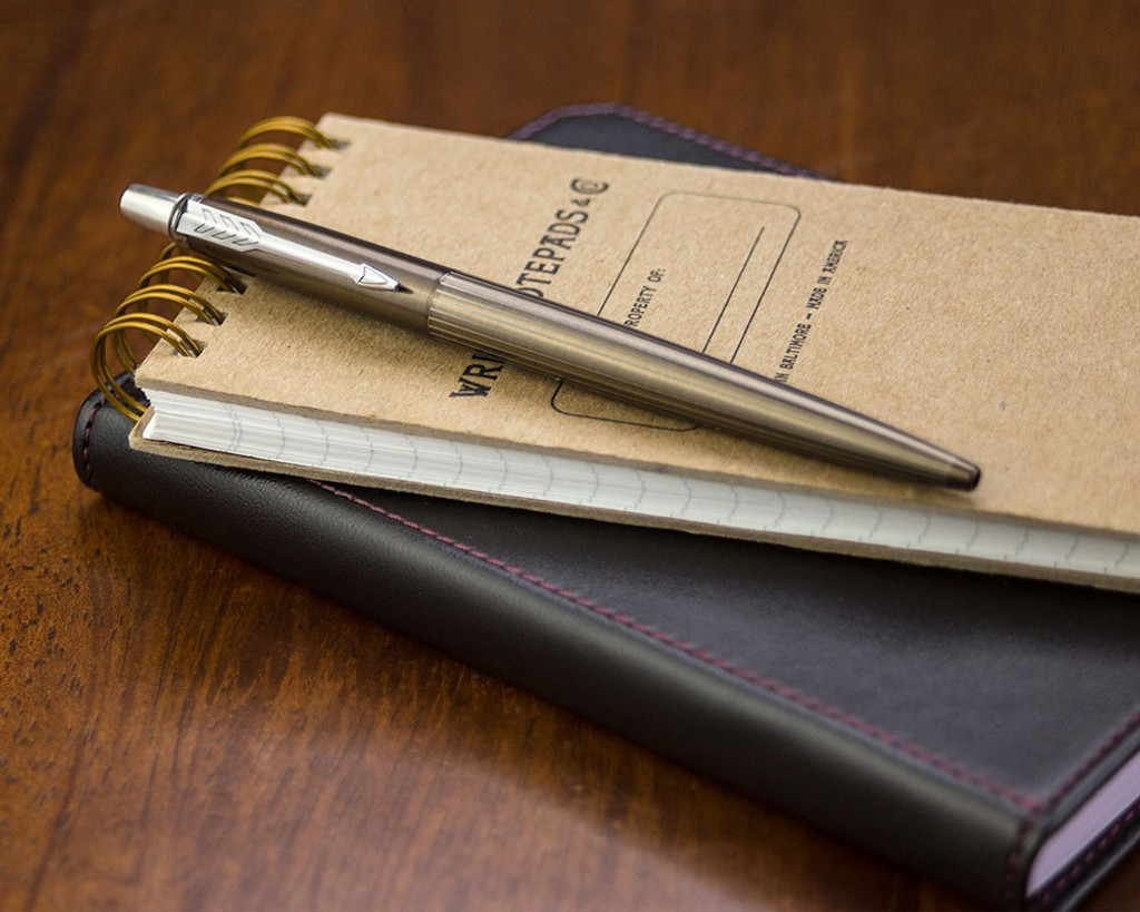 Parker Jotter Premium Ballpoint - Carlisle Brown Pinstripe - Closed on Notebook