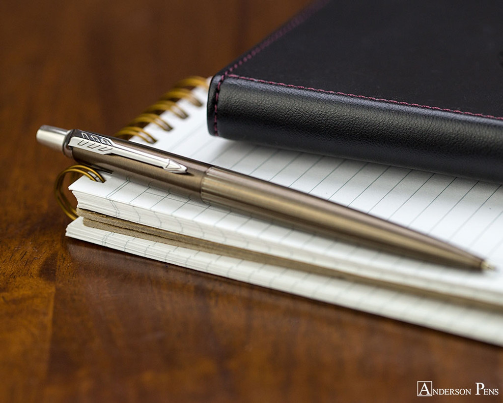 Parker Jotter Premium Ballpoint - Carlisle Brown Pinstripe - Open on Notebook