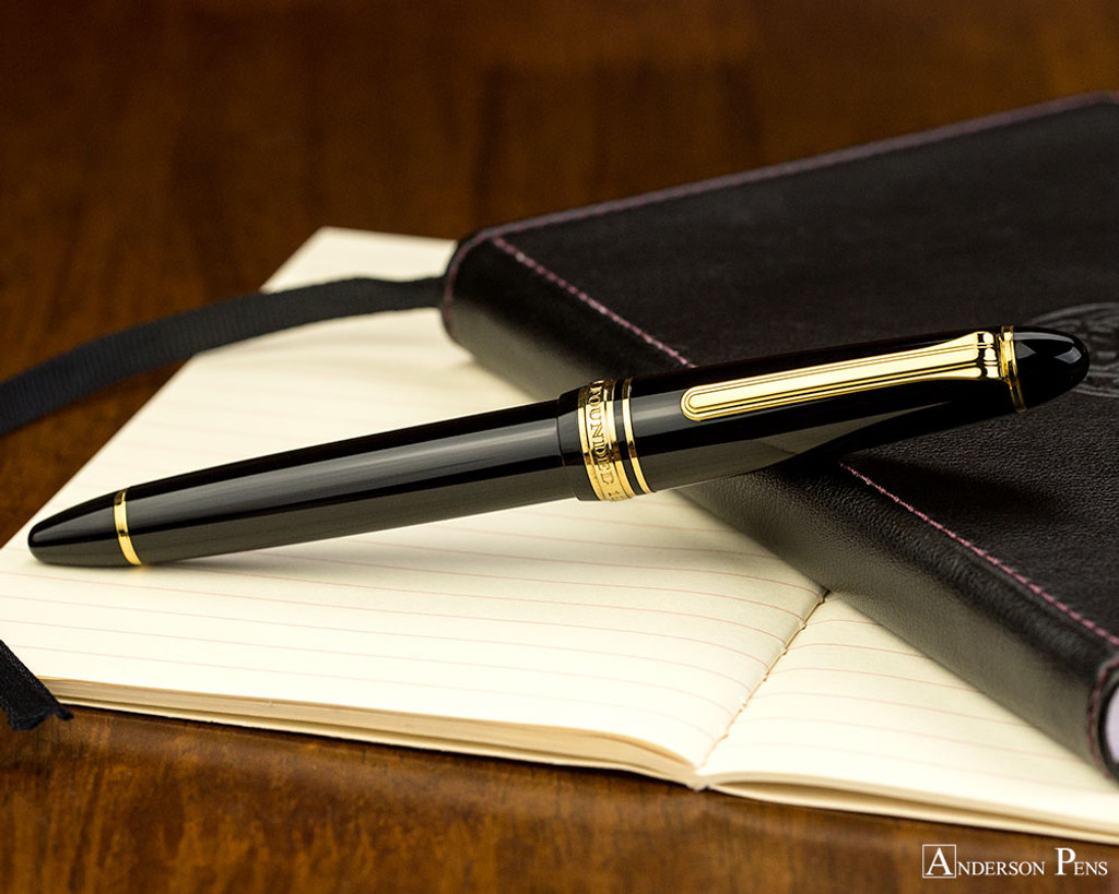 Sailor 1911 Standard Fountain Pen - Black with Gold Trim - Closed on Notebook