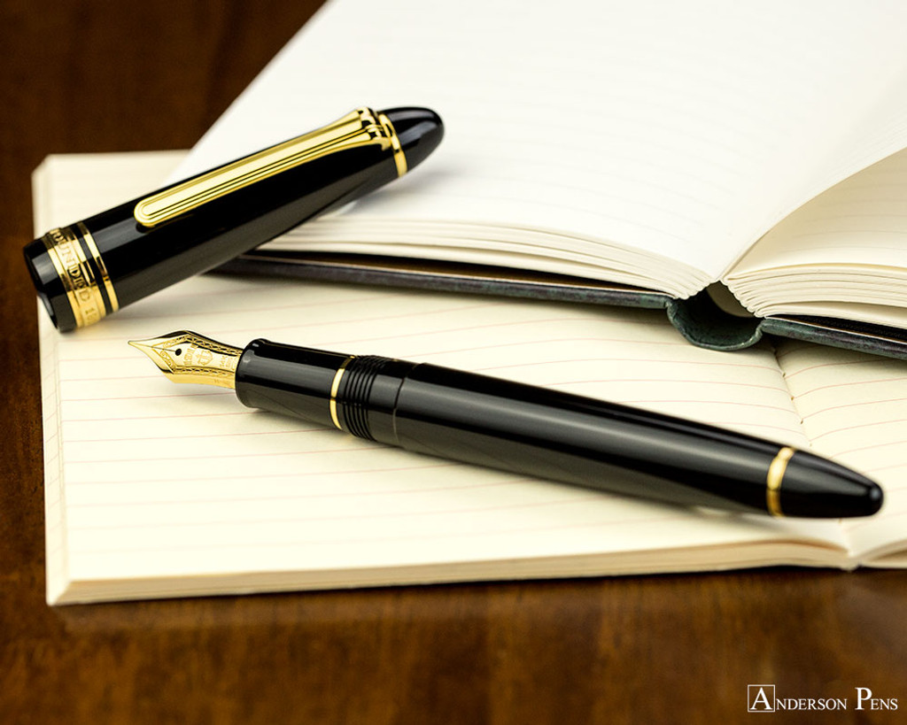Sailor 1911 Standard Fountain Pen - Black with Gold Trim - Open on Notebook