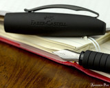 Faber-Castell Essentio Black Carbon Fountain Pen - Nib on Notebook