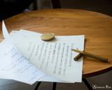ystudio Classic Brass Copper Rollerball Pen - On Table