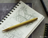 ystudio Classic Brass Sketching Pencil - On Notebook