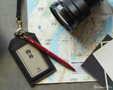 ystudio Brassing Portable Ballpoint - Red - Hanging from Luggage Tag