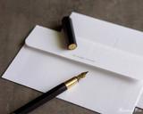 ystudio Resin and Brass - Black Fountain Pen - On Envelope