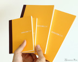 Hobonichi Plain Notebooks - A6 - Group in Hand
