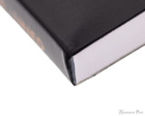 Rhodia No. 18 Notepad - 8.25 x 11.75, Lined Paper, 3 Hole Punched - Black - Binding