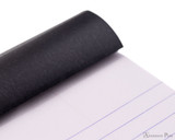 Rhodia No. 18 Notepad - 8.25 x 11.75, Lined Paper, 3 Hole Punched - Black - Flipped Open