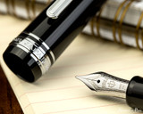 Sailor Pro Gear Slim Fountain Pen - Black with Rhodium Trim - Nib on Notebook