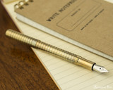 Kaweco Liliput Fountain Pen - Eco Brass Wave - Posted on Notebook