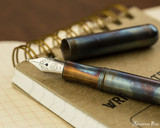 Kaweco Liliput Fountain Pen - Fireblue - Open on Notebook