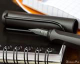 Lamy Safari Fountain Pen - Charcoal - Nib Closeup on Notebook
