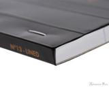 Rhodia No. 13 Staplebound Notepad - A6, Lined - Black binding detail