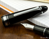 Sailor 1911 Large Fountain Pen - Black with Rhodium Trim - Nib on Notebook
