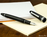 Sailor 1911 Large Fountain Pen - Black with Rhodium Trim - Open on Notebook