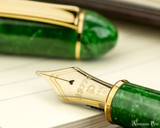 Platinum 3776 Celluloid Fountain Pen - Jade - Nib on Notebook