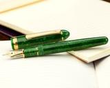 Platinum 3776 Celluloid Fountain Pen - Jade - Open on Notebook