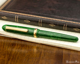 Platinum 3776 Celluloid Fountain Pen - Jade - Closed on Notebook
