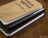Pilot Metropolitan Fountain Pen - Black Plain - On Notebook
