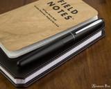 Pilot Metropolitan Fountain Pen - Black Plain - On Notebook