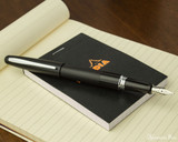 Pilot Metropolitan Fountain Pen - Black Plain - Open on Notebook