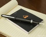 Pilot Metropolitan Fountain Pen - Black Plain - Open on Notebook
