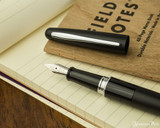 Pilot Metropolitan Fountain Pen - Black Plain - Nib on Notebook