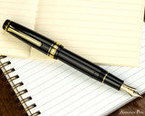 Sailor Pro Gear Fountain Pen - Black with Gold Trim - Posted on Notebook