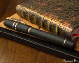 Visconti Homo Sapiens Fountain Pen - Lava Bronze - Closed on Notebook