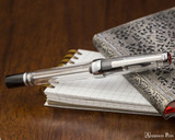 TWSBI Vac 700R Fountain Pen - Clear - Closed on Notebook
