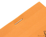 Rhodia No. 12 Staplebound Notepad - 3.375 x 4.75, Graph - Orange staple detail