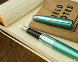 Pilot Metropolitan Fountain Pen - Retro Pop Turquoise - Open on Notebook