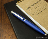 Sheaffer VFM Ballpoint - Neon Blue - On Notebook
