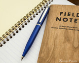 Sheaffer VFM Ballpoint - Neon Blue - Open on Notebook