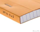 Rhodia No. 16 Staplebound Notepad - A5, Graph - Orange binding detail