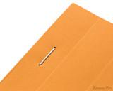 Rhodia No. 16 Staplebound Notepad - A5, Graph - Orange staple detail